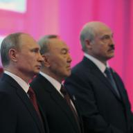 Russian President Vladimir Putin (L), Kazakh President Nursultan Nazarbayev (C) and Belarus President Alexander Lukashenko stand for a photograph before a meeting of the Eurasian Economic Union in Astana May 29, 2014. The presidents of Russia, Kazakhstan and Belarus signed a treaty on Thursday creating a vast trading bloc which they hope will challenge the economic might of the United States, the European Union and China. The treaty forging the Eurasian Economic Union will come into force on Jan. 1, once it has passed the formality of being approved by the three former Soviet republics' parliaments. REUTERS/Mikhail Klimentyev/RIA Novosti/Kremlin (KAZAKHSTAN - Tags: POLITICS BUSINESS) ATTENTION EDITORS - THIS IMAGE HAS BEEN SUPPLIED BY A THIRD PARTY. IT IS DISTRIBUTED, EXACTLY AS RECEIVED BY REUTERS, AS A SERVICE TO CLIENTS - RTR3RC2W